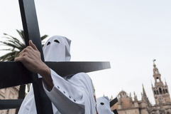 Penitent with cross. Picture of a penitent of the holly week of Seville, Spain Stock Photography