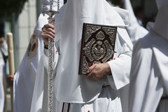 Penitent with the rule book governing the brotherhood with velvet caps and appliques of embossed silver. Spain Stock Photos