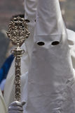 Penitent with staff of silver during a procession of holy week Royalty Free Stock Images