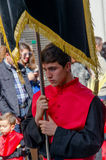 Penitent. VALLADOLID - 29 MARCH: A penitent holds a brotherhood pennant on March 29, 2015 in Valladolid, Spain. Valladolid has some os the most famous Stock Images