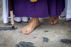 Penitent walking with barefoot. Holy Week in Spain royalty free stock photography