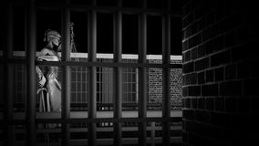 The penitentiary bars and Lady of Justice 3d rendering. The penitentiary bars and Lady of Justice Royalty Free Stock Image