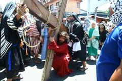 Penitents αναπαριστώντας το πάθος Χριστού Στοκ Φωτογραφίες