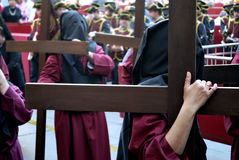 Penitents carrying large crosses in the Holy Week of Cordoba Stock Image
