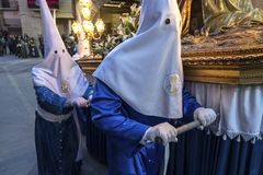 Penitents in easter week celebrations in Spain. Penitents in easter week celebrations. Penitents in their procession in Spain royalty free stock images
