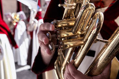 Penitents playing trumpets during Holy week Royalty Free Stock Image
