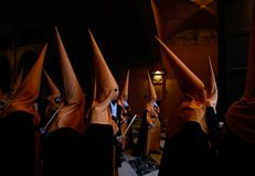 Penitents wait on queue before the start of an easter holy week procession in mallorca detail on hoods side view. Penitents wait in queue in the church before royalty free stock photos