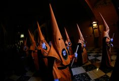 Penitents wait on queue before the start of an easter holy week procession in mallorca detail on hoods wide. Penitents wait in queue in the church before taking royalty free stock image