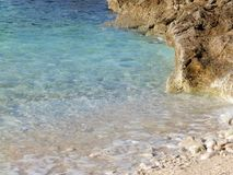 Pebbles beach, Penizule beach, Istria, Croatia. Penizule beach is one of the most popular beaches on Cape Kamenjak. It is located in the cove of the same name on royalty free stock photo