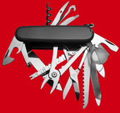 Penknife. Multitool Penknife isolated on red Royalty Free Stock Photo