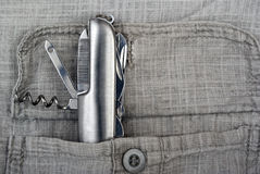 Penknife. In a pocket of a gray shirt Stock Image
