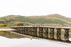 Penmaenpool toll bridge, evening. Wooden structure Penmaenpool toll bridge, over the River Mawddach near Dolgellau, Wales, United Kingdom Stock Images