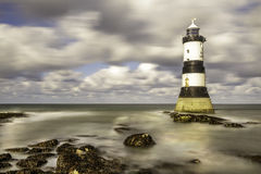 Penmom Lighthouse Anglesey north west cost wales. Pen mom Lighthouse Anglesey north west cost wales Royalty Free Stock Image