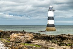 The Penmon point lighthouse is located close to Puffin Island on Anglesey, Wales - United Kingdom.  Stock Photography