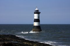 Penmon Priory and Black Point Royalty Free Stock Images