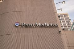 Penn Medicine sign and logo is seen on the side of a building in center city royalty free stock photo