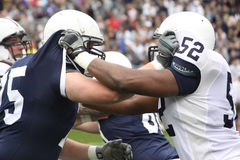 Penn State linemen go through blocking drills Stock Photo