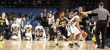 Penn State's D. J. Newbill is defended by Michigan's Trey Burke. And Jordan Morgan Royalty Free Stock Photo