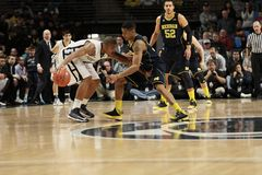 Penn State's D.J. Newbill. Dribbles as Michigan's Trey Burke defends Royalty Free Stock Photo