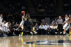Penn State's Nick Colela is fouled by Michigan's Tim Hardaway Royalty Free Stock Photo