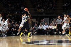 Penn State's Nick Colela is fouled by  Michigan's Tim Hardaway Royalty Free Stock Images