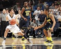 Penn State's  Penn State's Nick Coletta is defended by Michigan's Trey Burke. Penn State's Nick Coletta is defended by Michigan's Trey Burke as he fakes a shot Royalty Free Stock Photography