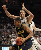 Penn State's Ross Travis defends Michigan's Trey Burke. At the Byrce Jordan Center Stock Images