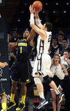 Penn State's Sasa Borovnjak shoots over  Michigan's Glenn Robinson III Royalty Free Stock Image