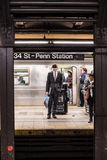 Penn Station NYC. NEW YORK CITY - MARCH 13, 2015:  Manhattan commuters on subway platform in Penn Station waiting for train Stock Photography
