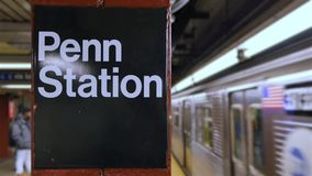 The Penn Station Subway ID Sign as Train Approaches. 7969 NEW YORK - Circa December, 2016 - The Penn Station subway ID sign as a train approaches stock footage