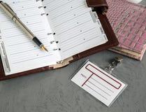 Penna öppen anteckningsbok, emblem royaltyfri bild