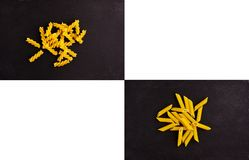 Penna και ζυμαρικά Fusilli στη μαύρη βάση πλακών Στοκ Εικόνες