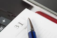 Penna alla pagina del taccuino Immagine Stock