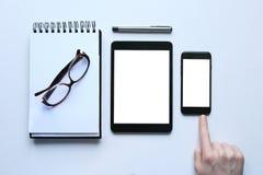 Penna, anteckningsbok och behändigt Arkivfoton
