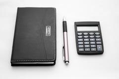 Penna, blocco note e calcolatore Fotografia Stock Libera da Diritti