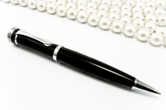 Penna con le perle Immagini Stock