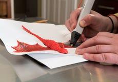 penna 3-D di stampa che crea una forma del drago Immagine Stock Libera da Diritti