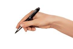 Penna del nero del whith della mano fotografie stock libere da diritti