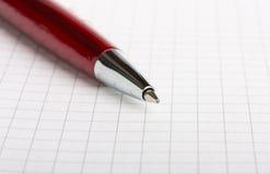 Penna di Ballpoint sul taccuino Fotografia Stock Libera da Diritti