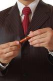 Penna di holding dell'uomo di affari Fotografie Stock