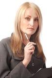 Penna di holding della donna ed appunti Fotografia Stock Libera da Diritti