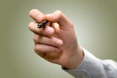 Penna di holding della mano Immagini Stock Libere da Diritti