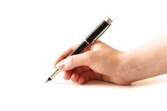 Penna di holding della mano isolata fotografia stock libera da diritti