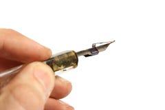 Penna di spoletta nella mano fotografia stock libera da diritti