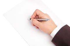 Penna di tenuta della mano isolata su fondo bianco Fotografie Stock