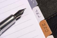 Penna e blocchetto per appunti Fotografia Stock