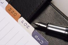 Penna e blocchetto per appunti Immagine Stock