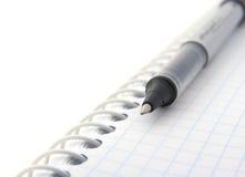 Penna e blocchetto per appunti fotografie stock