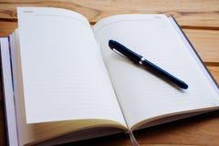 Penna e blocco note Fotografia Stock