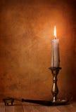 Penna e candela fotografia stock